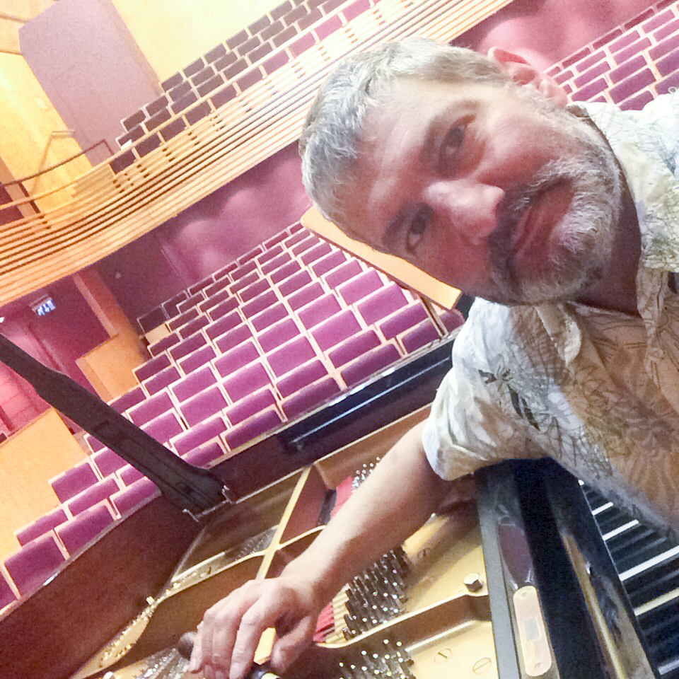 Tim Hendy tuning a Steinway concert grand at The Menuhin Hall