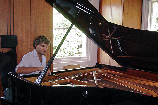 Tim Hendy tuning a Steinway Grand for a private client