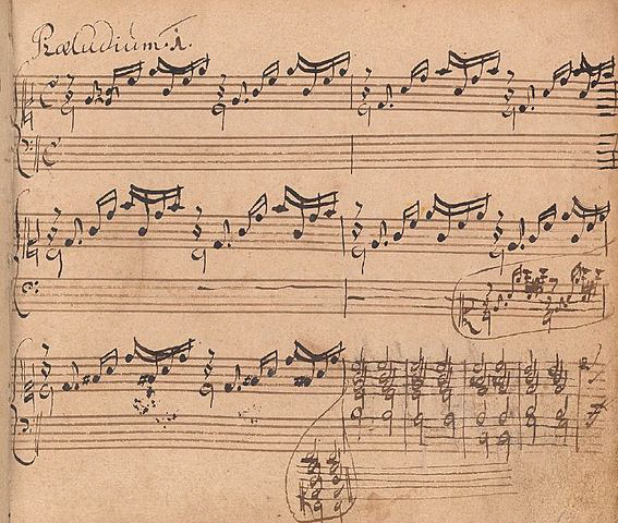 Sepia-coloured manuscript, three staves with notation in Bach's handwriting
